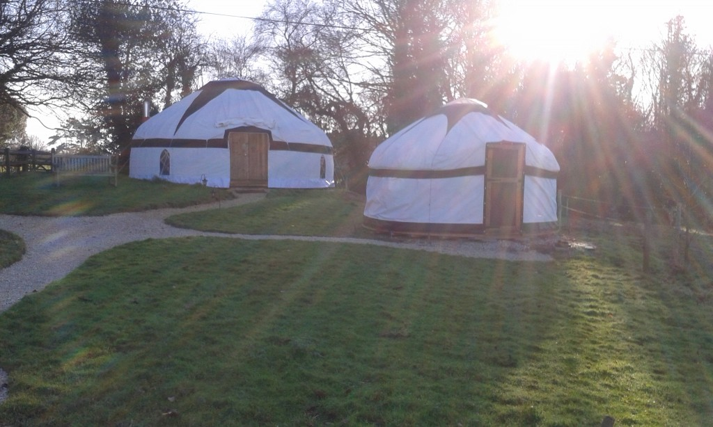 Yurts from washroom in sunlight